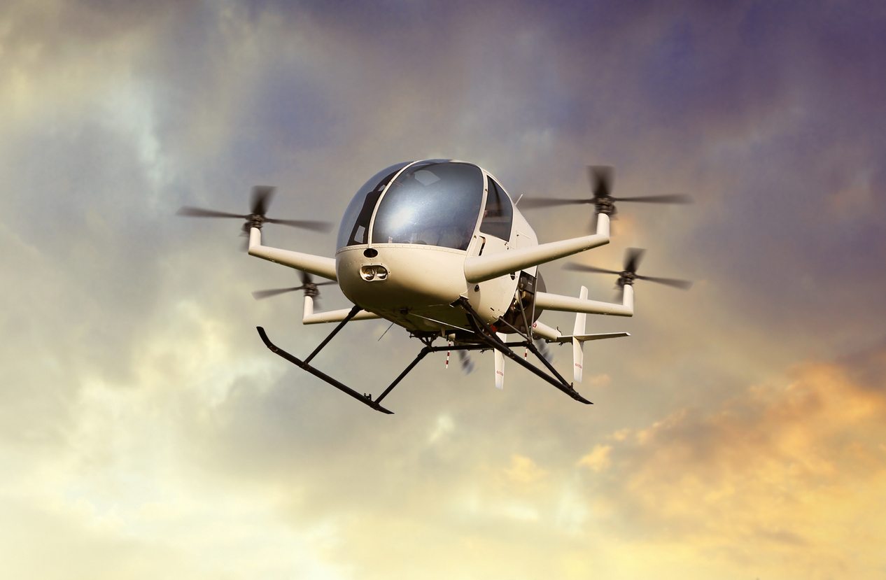Flying futuristic drone transporting people