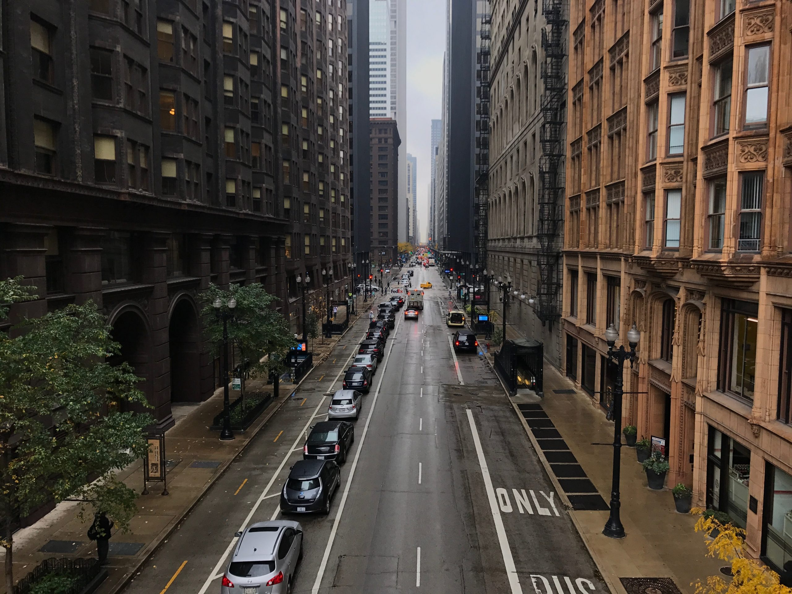 This image shows Dearborn Street in Chicago looking in the direct traffic is traveling.