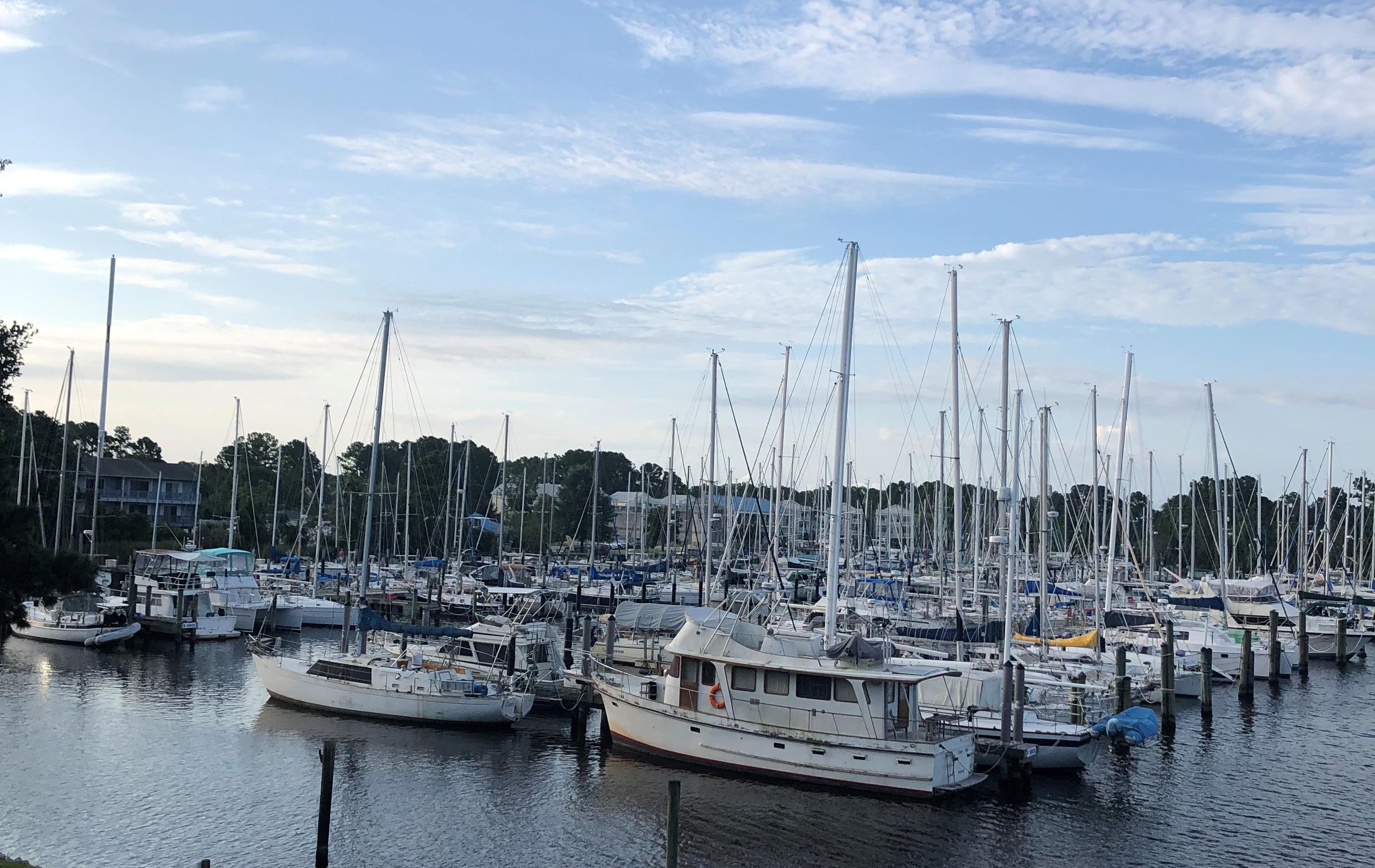 This image shows boats in a harbor in Carolina Beach, North Carolina.